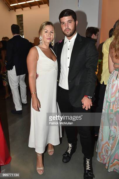 Serena Kerrigan and Andrew Warren attend the Parrish Art Museum Midsummer Party 2018 at Parrish Art Museum on July 14 2018 in Water Mill New York