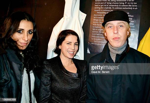 Serena Rees Sadie Frost and James Brown attend the launch of the Stutterheim Raincoats pop up shop in Shoreditch on November 22 2012 in London England