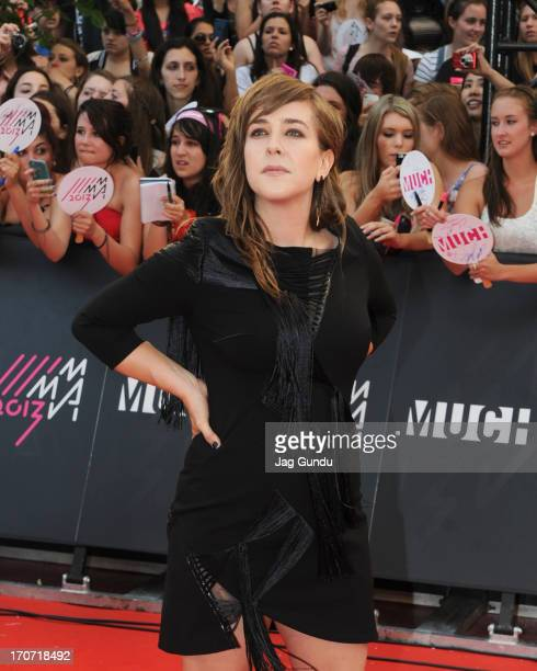 Serena Ryder arrives on the red carpet at the 2013 MuchMusic Video Awards at Bell Media Headquarters on June 16 2013 in Toronto Canada