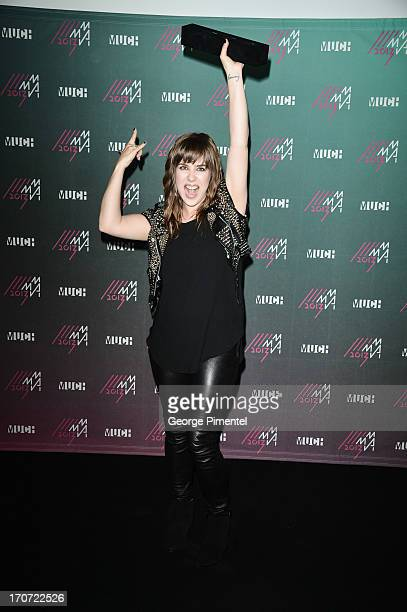 Serena Ryder poses in the press room at the 2013 MuchMusic Video Awards at MuchMusic HQ on June 16 2013 in Toronto Canada