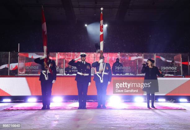 Serena Ryder sings the Canadian national anthem during the 2017 Scotiabank NHL100 Classic at Lansdowne Park on December 16 2017 in Ottawa Canada