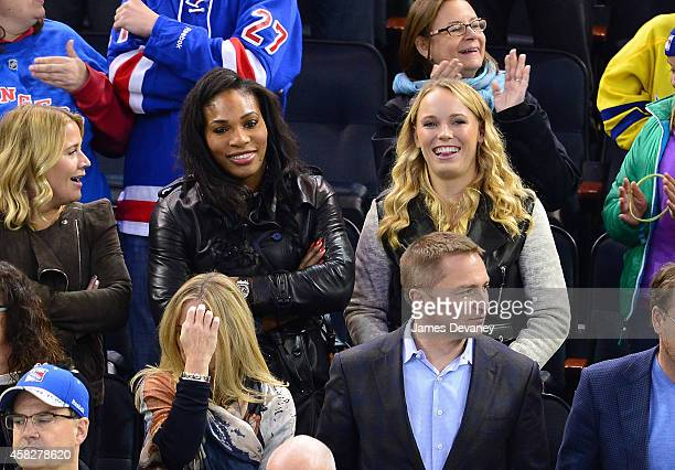 Serena Williams and Caroline Wozniacki attend New York Rangers vs Winnipeg Jets at Madison Square Garden on November 1 2014 in New York City