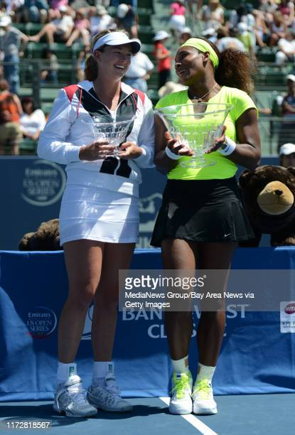 Serena Williams and Coco Vandeweghe chat while posing for photographs following Williams 7-5, 6-3 win for the final match of the Bank of the West...