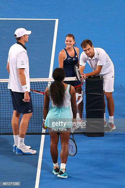 Serena Williams and John Isner of the United States together with Agnieszka Radwanska and Jerzy Janowicz of Poland wait for a decision from ITF...
