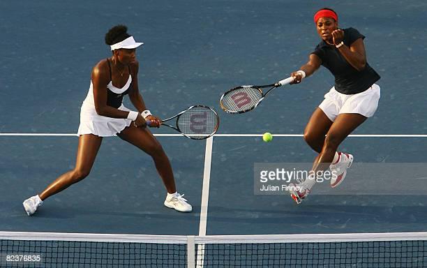 Serena Williams and teammate Venus Williams of the United States take on Alona Bondarenko and Kateryna Bondarenko of the Ukraine during the women's...