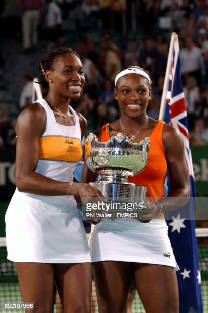 Serena Williams and Venus Williams hold the trophy after winning the Womens Doubles Final against Virginia Ruano Pascual and Paola Suarez