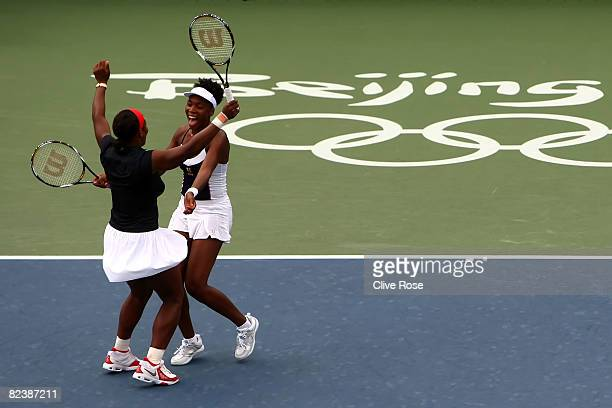 Serena Williams and Venus Williams of the United States celebrate winning the gold medal over Virginia Ruano Pascual and Anabel Medina Garrigues of...