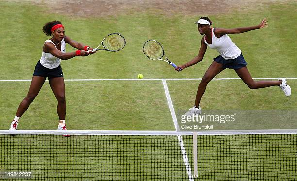 Serena Williams and Venus Williams of the United States return a shot against Andrea Hlavackova and Lucie Hradecka of Czech Republic during the...