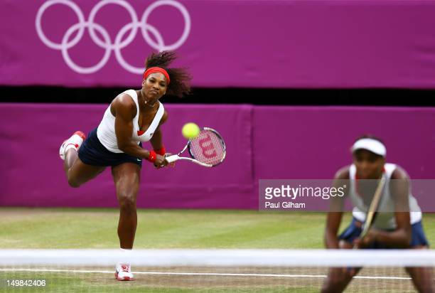 Serena Williams and Venus Williams of the United States serve the ball to Andrea Hlavackova and Lucie Hradecka of Czech Republic during the Women's...