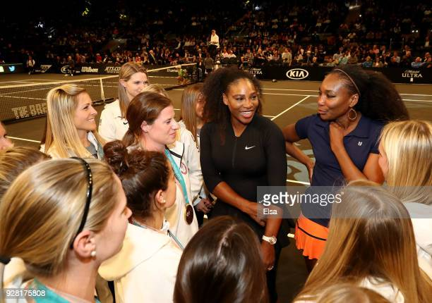 Serena Williams and Venus Williams of the United States talk with the Women's Olympic hockey team during the Tie Break Tens at Madison Square Garden...