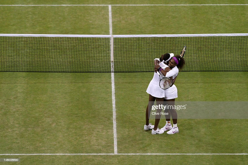 Serena Williams (R) and Venus Williams of the USA celebrate match point during their Ladies' Doubles final match against Andrea Hlavackova and Lucie Hradecka of the Czech Republic on day twelve of the Wimbledon Lawn Tennis Championships at the All England Lawn Tennis and Croquet Club on July 7, 2012 in London, England.