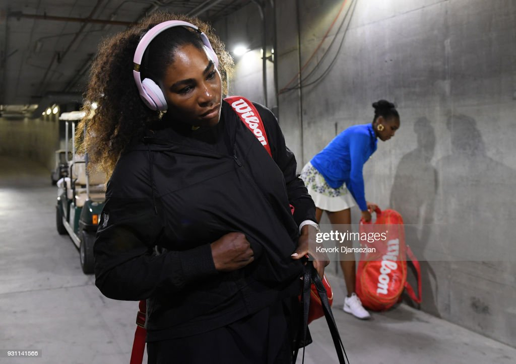 Serena Williams (L) and Venus Williams of United States arrive for their tennis match during Day 8 of BNP Paribas Open on March 12, 2018 in Indian Wells, California.