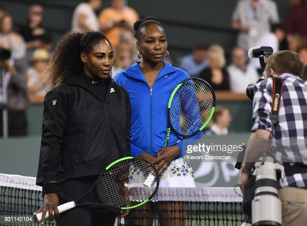 Serena Williams and Venus Williams of United States pose before the start of their tennis match during Day 8 of BNP Paribas Open on March 12 2018 in...