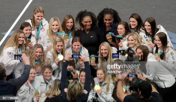 Serena Williams and Venus Williams pose with the Team USA Women's Hockey Team during the Tie Break Tens at Madison Square Garden on March 5 2018 in...