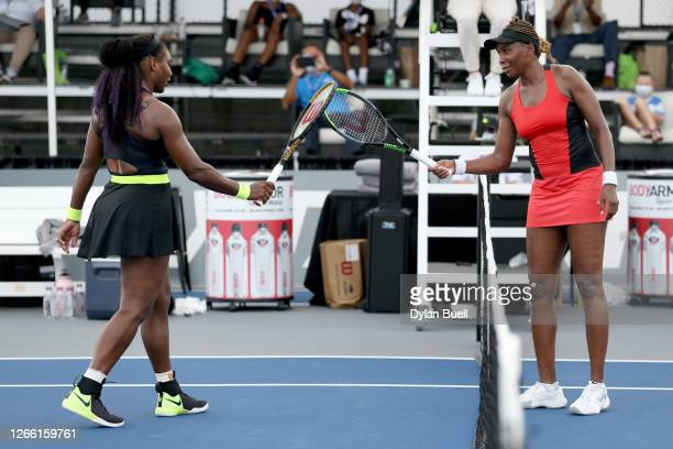 Serena Williams and Venus Williams touch rackets after Serena Williams defeated Venus Williams 3-6, 6-3, 6-4 during Top Seed Open - Day 4 at the Top...