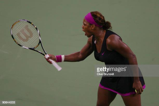 Serena Williams argues a call by the line judge which led to her disqualification during the Women's Singles Semifinal match against to Kim Clijsters...