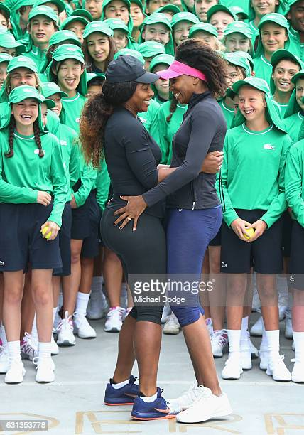 Serena Williams arrives to the suprise of sister Venus Williams of the USA as Australian Open Tournament Director Craig Tiley introduces them to over...