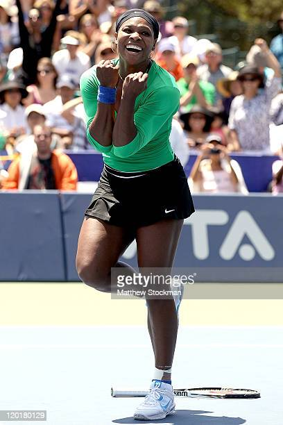 Serena Williams celebrates match point against Marion Bartoli of France during the final of the Bank of the West Classic at the Taube Family Tennis...