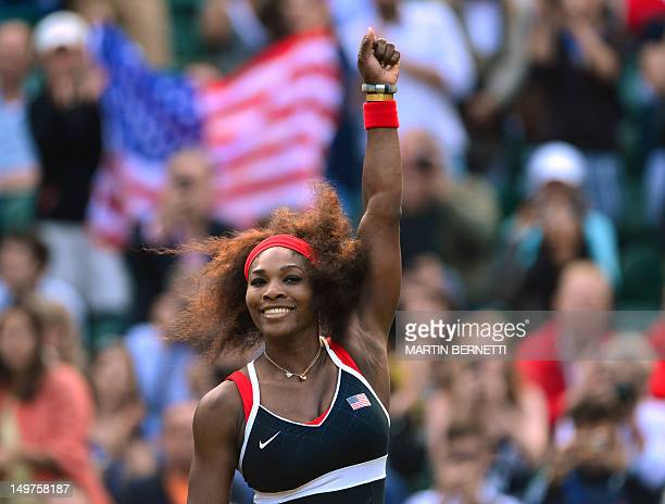 US Serena Williams celebrates victory over Belarus' Victoria Azarenka during their women's singles semifinal round match at the 2012 London Olympic...