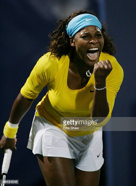 Serena Williams celebrates winning match point in the second set tiebreak over Na Li of China at the Bank of the West Classic Day Two at Stanford...
