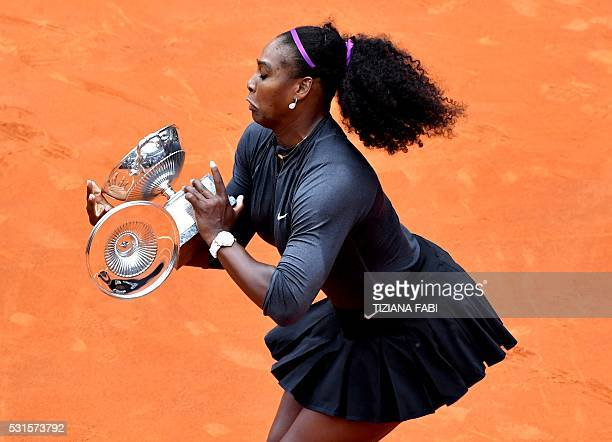 US Serena Williams drops a piece of the trophy after winning the final match of the WTA Tennis Open tournament game against US Madison Keys at the...