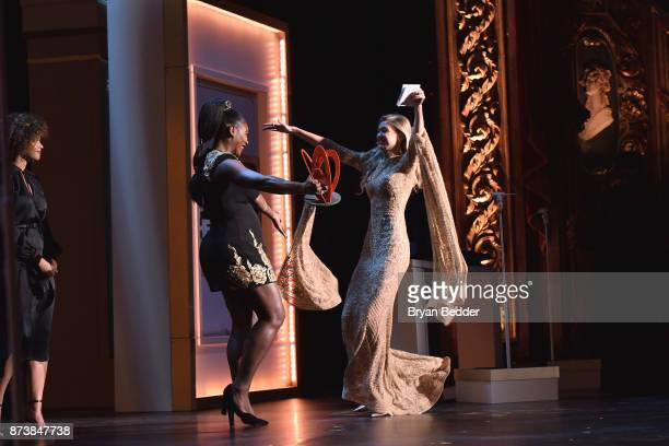 Serena Williams embraces Gigi Hadid onstage at Glamour's 2017 Women of The Year Awards at Kings Theatre on November 13 2017 in Brooklyn New York
