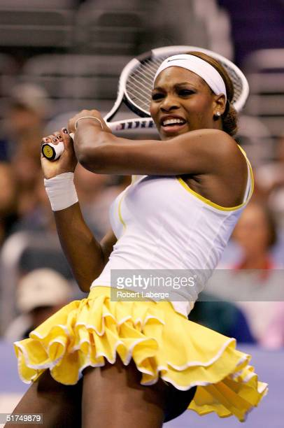 Serena Williams follows through on a shot to Maria Sharapova of Russia in the finals of the WTA Tour Championship Tournament at Staples Center on...