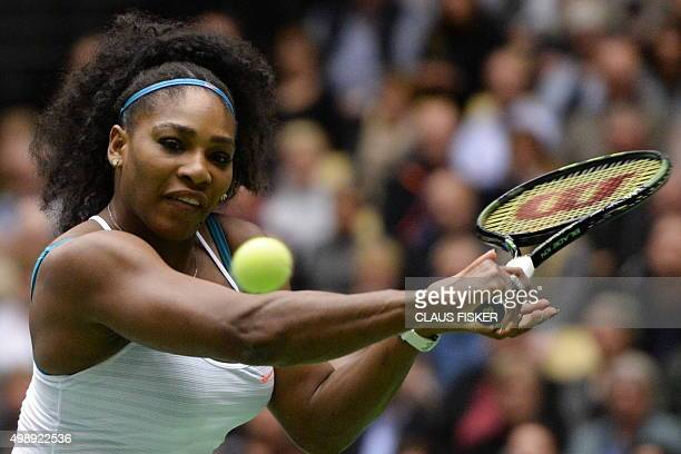 Serena Williams from the US returns a ball to Danish tennis player Caroline Wozniacki during their Champions Battle exhibition game in benefit of the...