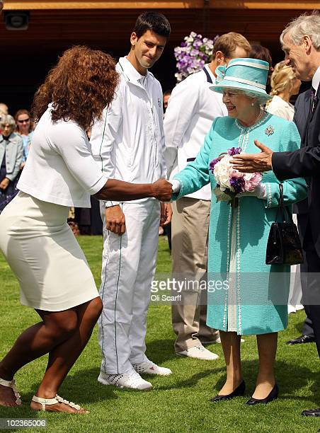 Serena Williams greets Queen Elizabeth II as she attends the Wimbledon Lawn Tennis Championships on Day 4 at the All England Lawn Tennis and Croquet...
