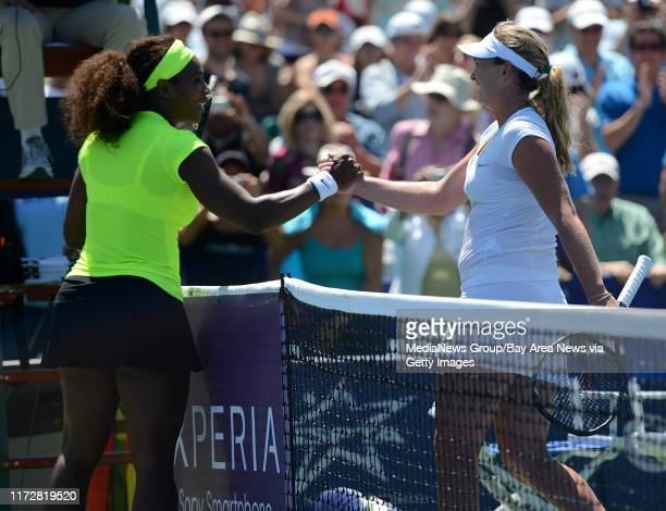 Serena Williams high-fives Coco Vandeweghe following Williams' 7-5, 6-3 win for the final match of the Bank of the West Classic tennis tournament at...