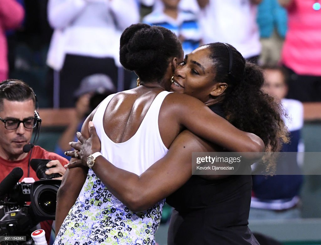 Serena Williams hugs Venus Williams after her loss to her sister during Day 8 of BNP Paribas Open on March 12, 2018 in Indian Wells, California. Venus Williams won 6-3, 6-4.