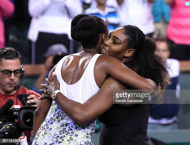 Serena Williams hugs Venus Williams after her loss to her sister during Day 8 of BNP Paribas Open on March 12 2018 in Indian Wells California Venus...