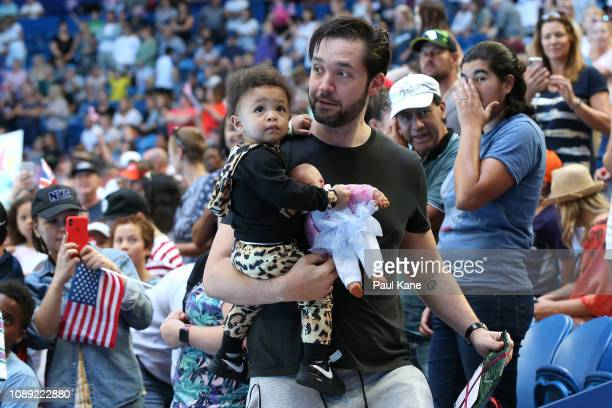 Serena Williams' husband Alexis Ohanian carries their daughter Alexis Olympia Ohanian Jr from the team box following the women's singles match...