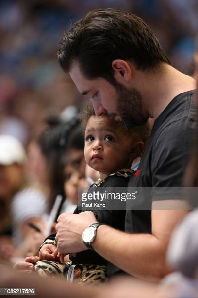 Serena Williams' husband Alexis Ohanian sits court side with their daughter Alexis Olympia Ohanian Jr during the women's singles match between Serena...