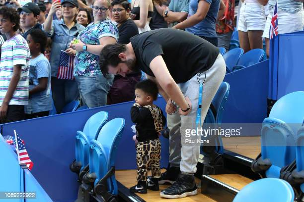 Serena Williams' husband Alexis Ohanian talks to their daughter Alexis Olympia Ohanian Jr following the women's singles match between Serena Williams...