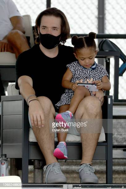 Serena Williams' husband and daughter, Alexis Ohanian and Alexis Olympia Ohanian, look on during the match between Serena Williams and Bernarda Pera...