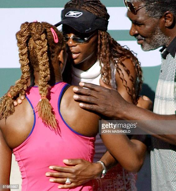 Serena Williams is congradulated by her sister Venus and father Richard after defeating Kim Clijsters of Belgium in the Tennis Masters Series final...