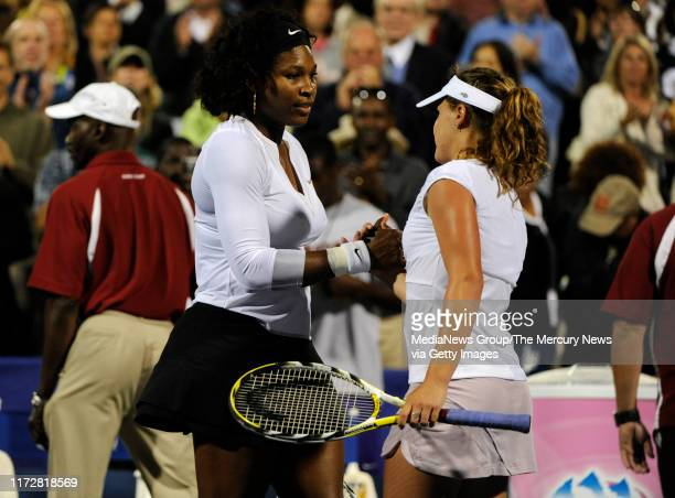 Serena Williams, left, and Michelle Larcher de Brito shake hands after Williams match win for the Bank of the West Classic in the Taube Family Tennis...