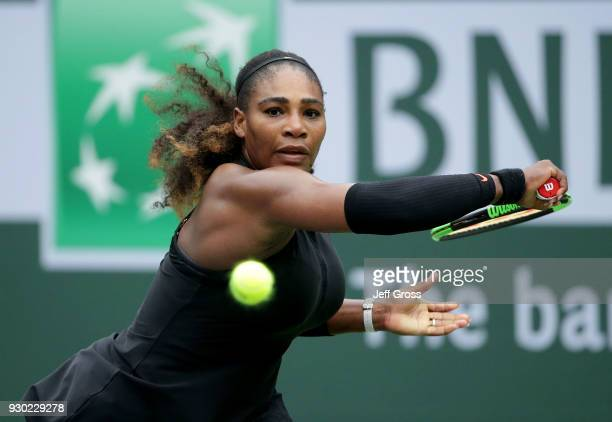 Serena Williams lunges to return a backhand to Kiki Bertens of the Netherlands during the BNP Paribas Open on March 10 2018 at the Indian Wells...
