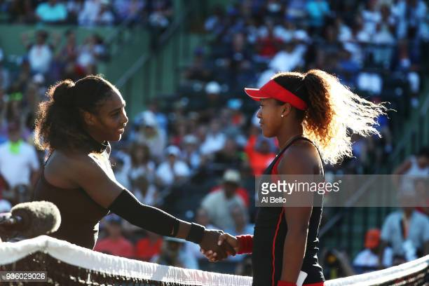 Serena Williams meets Naomi Osaka of Japan after losing to her in straight sets during Day 3 of the Miami Open at the Crandon Park Tennis Center on...