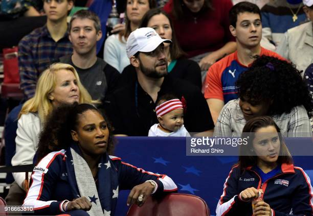 Serena Williams of Team USA bottom left along with her husband Alexis Ohanian and their daughter Alexis Olympia center watch the action during the...