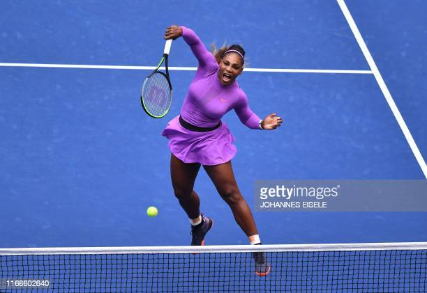 Serena Williams of th US hits a return to Bianca Andreescu of Canada during the Women's Singles Finals match at the 2019 US Open at the USTA Billie...