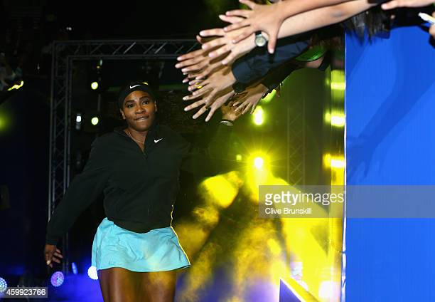 Serena Williams of the Singapore Slammers high fives the fans as she runs out for her teams match against the UAE Royals during the Coca-Cola...