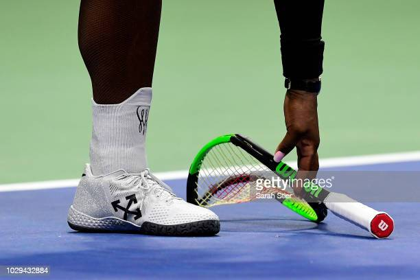 Serena Williams of the United States after smashing her racket during her Women's Singles finals match against Naomi Osaka of Japan on Day Thirteen...