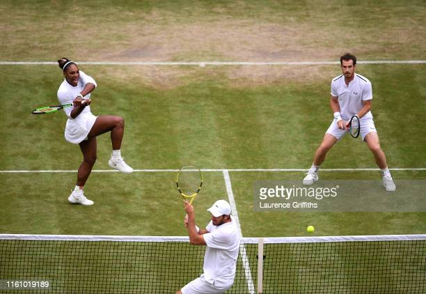 Serena Williams of the United States and Andy Murray of Great Britain in action in their Mixed Doubles second round match against Fabrice Martin of...
