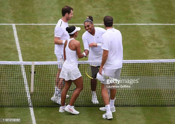 Serena Williams of the United States and Andy Murray of Great Britain shake hands at the net with Fabrice Martin of France and Raquel Atawo of the...