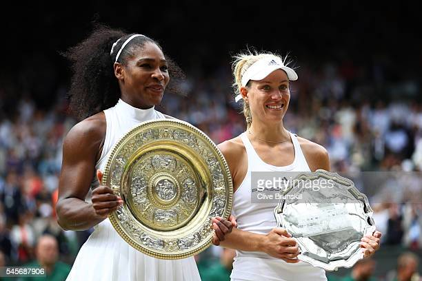 Serena Williams of The United States and Angelique Kerber of Germany in conversation as they hold their trophies following The Ladies Singles Final...
