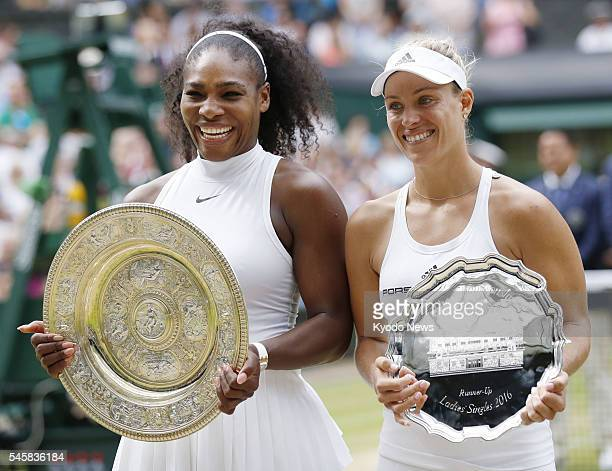 Serena Williams of the United States and Angelique Kerber of Germany pose with the winner's and runnerup's trophies respectively after the women's...