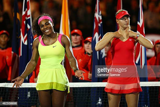 Serena Williams of the United States and Maria Sharapova of Russia stand at the presentation after Williams won their women's final match during day...