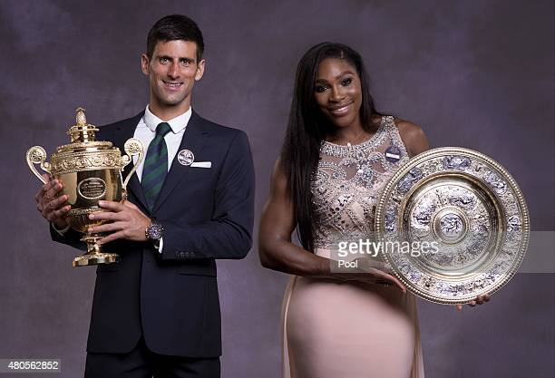 Serena Williams of the United States and Novak Djokovic of Serbia pose at the Champions Dinner at the Guild Hall on day thirteen of the Wimbledon...